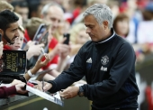 Football Soccer Britain - Manchester United v Everton - Wayne Rooney Testimonial - Old Trafford - 3/8/16 Manchester United manager Jose Mourinho signs a autograph before the match Action Images via Reuters / Jason Cairnduff Livepic EDITORIAL USE ONLY.