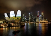 Garden of Light, an animation by Hexogon Solution of Singapore, is projected on the ArtScience Museum during a media preview of the i Light Marina Bay sustainable light art festival in Singapore March 7, 2012.  REUTERS/Edgar Su/File Photo